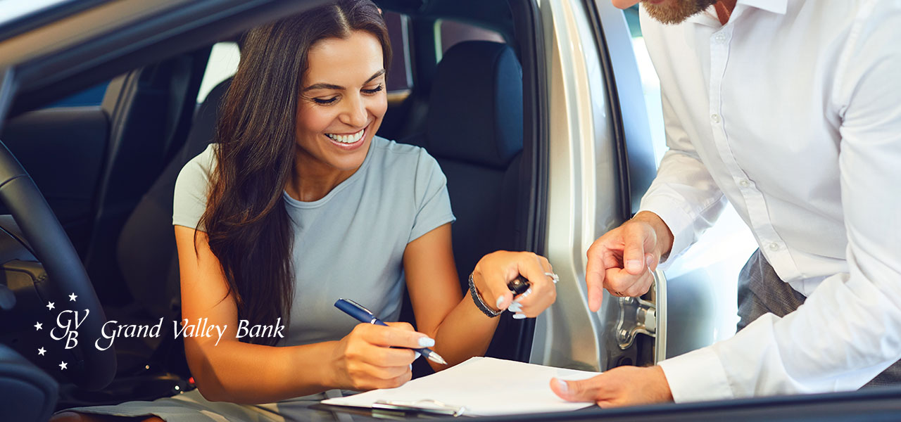 Woman signing a car rental contract