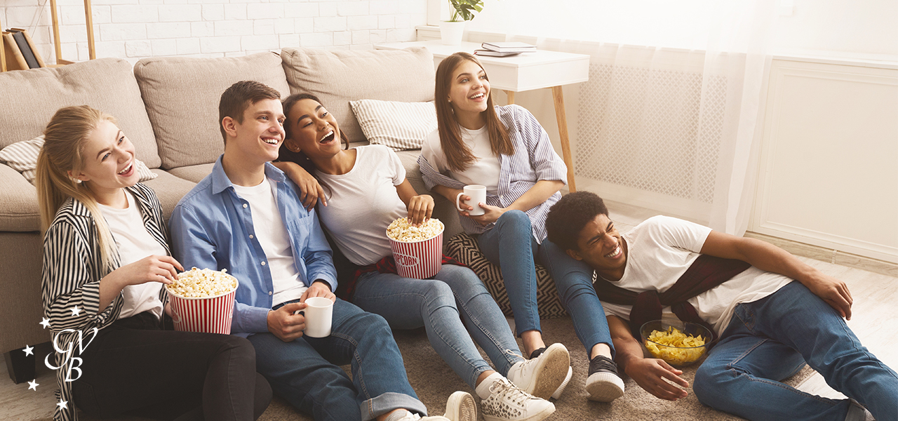 Photo of a group of friends watching streaming television